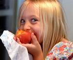 Girl Eating Peach.jpg